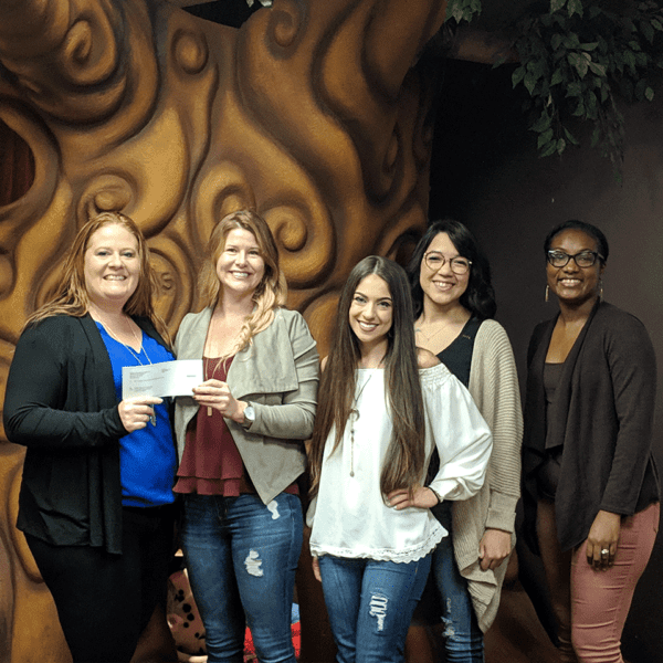 Group of women presenting a check